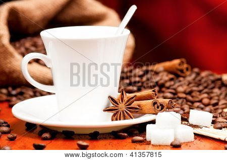 Cup of coffee with spices and lump sugar