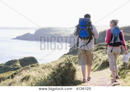 Couples On Cliffside Outdoors Walking
