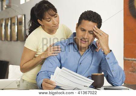 A woman consoling with a businessman while reading a document