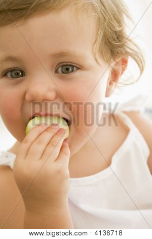 Baby Indoors Eating Apple