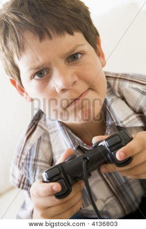 poster of Young Boy Holding Video Game Controller Looking Confused