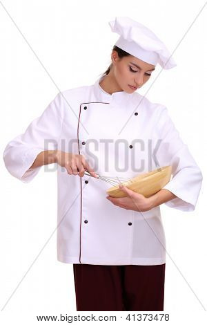 Portrait of young woman chef with wisk isolated on white