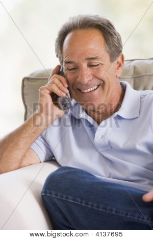 Man Indoors Using Telephone Smiling