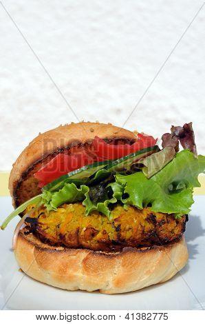 Veggie burger in sesame seed bun.