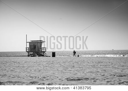 Lifeguard Station And Two Men,venice Beach, Los Angeles, Usa