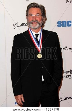 LOS ANGELES - JAN 18:  Kurt Russell arrives at the  Living Legends of Aviation Gala at Beverly Hilton Hotel on January 18, 2013 in Beverly Hills, CA