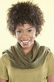 Portrait of an African American woman smiling with a stole round her neck over colored background