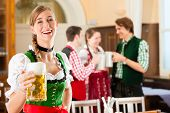 picture of stein  - Young people in traditional Bavarian Tracht in restaurant or pub - JPG