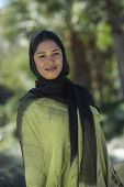 picture of dupatta  - Portrait of an Indian woman wrapped with black and green dupatta - JPG