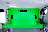 image of bouncing  - Green Screen video production studio with lights set ready for filming - JPG