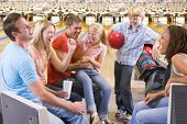 picture of bowling ball  - Portrait of young boy at bowling alley - JPG