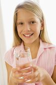 picture of drinking water  - Portrait of young girl with glass of water in hand - JPG