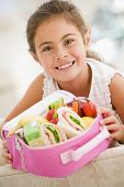 picture of healthy eating girl  - Portrait of young girl with healthy packed lunch - JPG