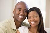 picture of close-up middle-aged woman  - Close up of a Couples sat on a sofa together smiling - JPG