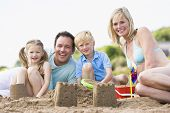 stock photo of family vacations  - Families on coastal walk across cliffs - JPG