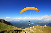 stock photo of parachute  - Paraglider prepareing to take off from a mountain - JPG