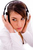 High Angle View Of Serious Woman Listening Music In Headphones