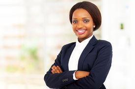 pic of half-dressed  - pretty african american businesswoman half length portrait in office - JPG