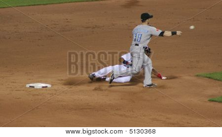 Red Sox Player Sliding Into Base