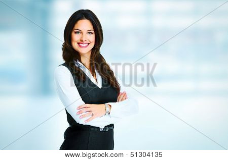 Young bussiness woman standing over office background