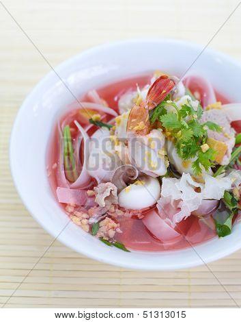 rice noodles in pink soup, thai cuisine