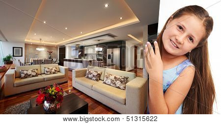 Little girl holding picture of modern apartment
