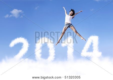 Excited Woman Jumps With New Year 2014