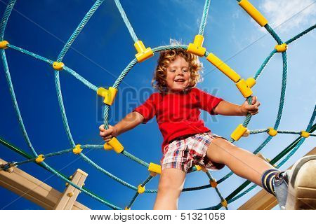Jumping From Ropes On Playground