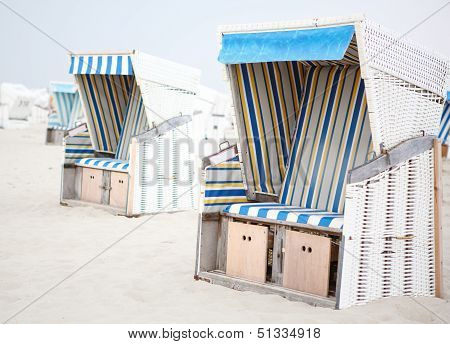 Colorful Beach Chairs With Stripes At The Beach Of St.peter Ording