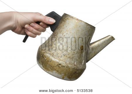 Woman Hand Holding Old Dirty Kettle