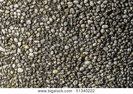 Old Pebble Stone Wall Pattern Closeup