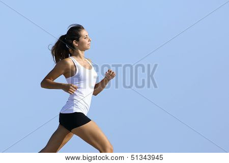 Side View Of A Woman Running With The Sky In The Background