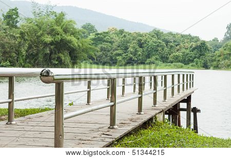 Metal Bridge Into The Lake