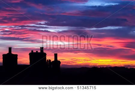 English summer sunset with silhouette chimneys
