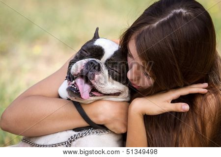 Giving Her Puppy A Hug