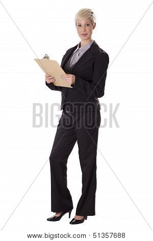 Full Length Portrait Of Business Woman With A Clipboard.