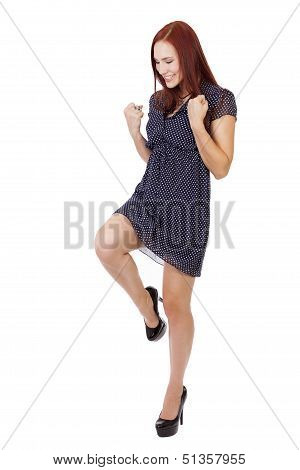 Pretty Woman With Red Hair Does A Victory Pose.