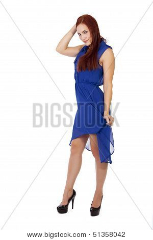 Beautiful Woman With Red Hair In A Blue Dress With Heels.