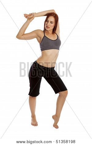 Young Woman In Workout Clothes Stretches Her Muscles.