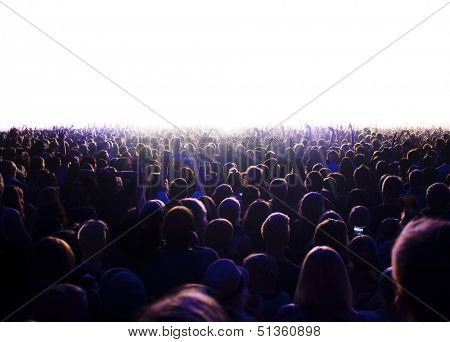 Audience is watching a luminous surface.