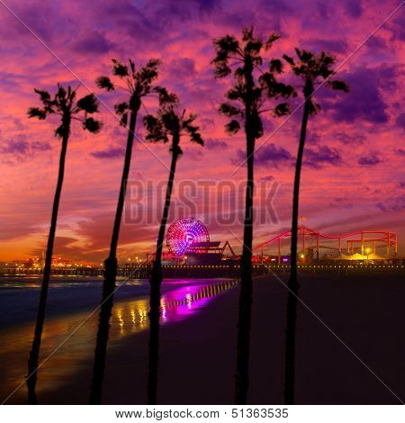 Santa Monica California sunset on Pier Ferrys wheel and reflection on beach wet sand photo illustration