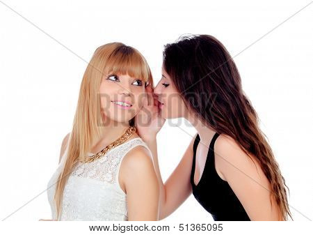 Two teen sisters whispering isolated on white background