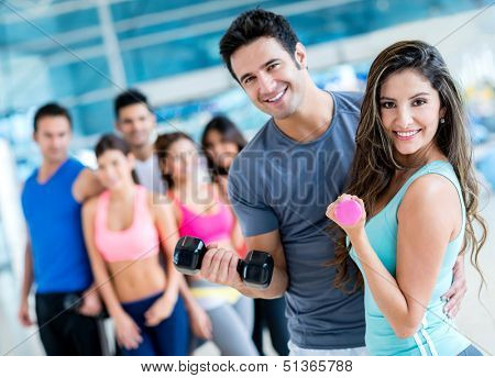Group of people at the gym looking very happy