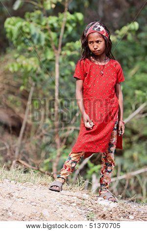 KALANKI, NEPAL - APRIL 2: Portrait of unidentified Nepalese girl in red dress on April 2, 2009 in Kalanki Village, Kathmandu, Central Region, Nepal.