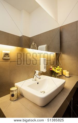 White Ceramic Sink On Grey Countertop