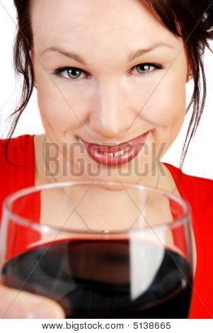 Attractive Woman With A Glass Of Red Wine