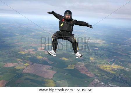 Skydiver In A Sit Position While In Freefall
