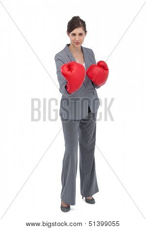 Competitive woman with boxing gloves on white background