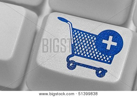 Computer Key With A Shopping Cart Symbol On It,
