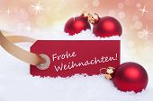 stock photo of weihnachten  - A Red Label with the German Words Frohe Weihnachten Which Means Merry Christmas as Christmas Background - JPG